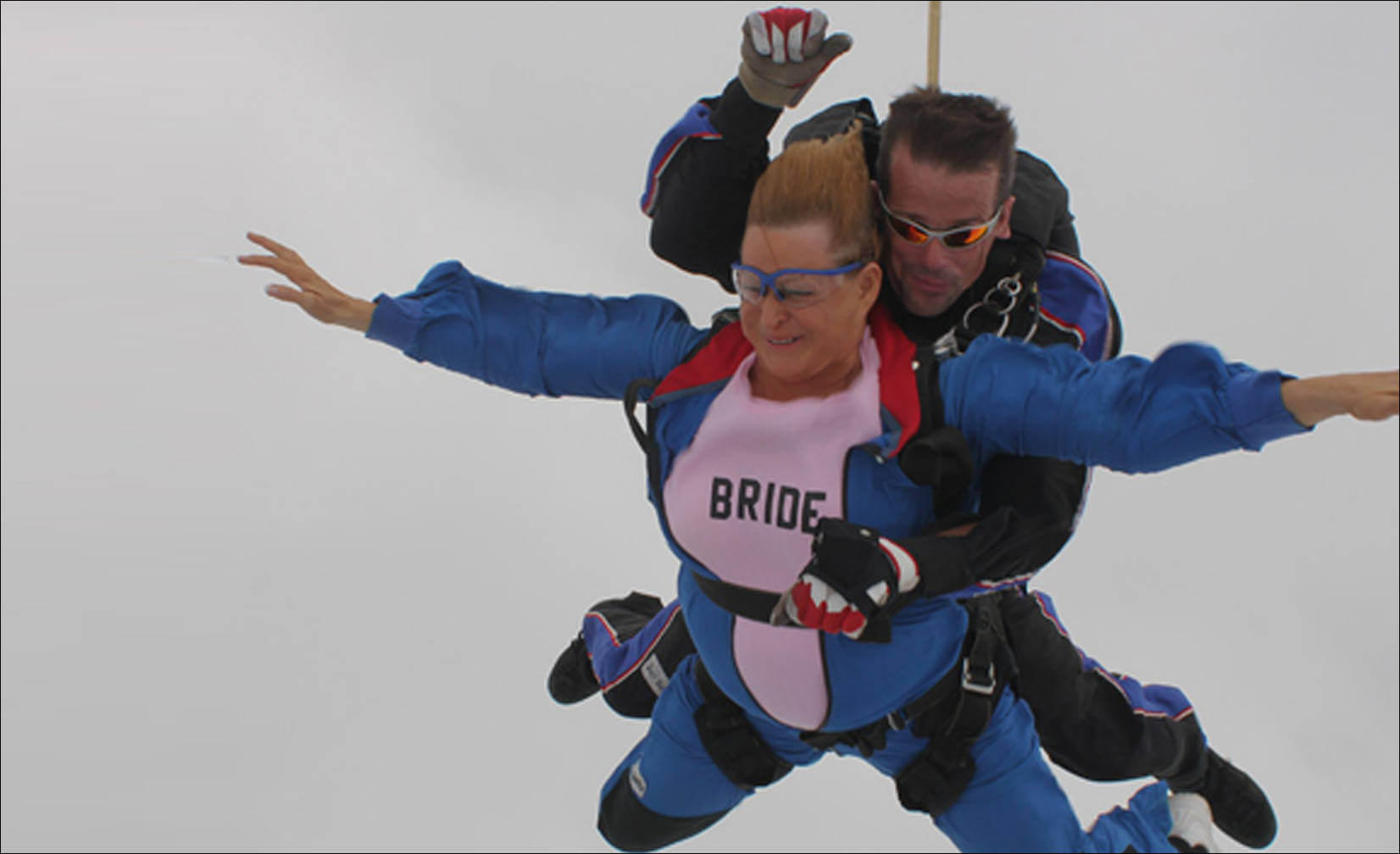 skydives following her 2011 wedding