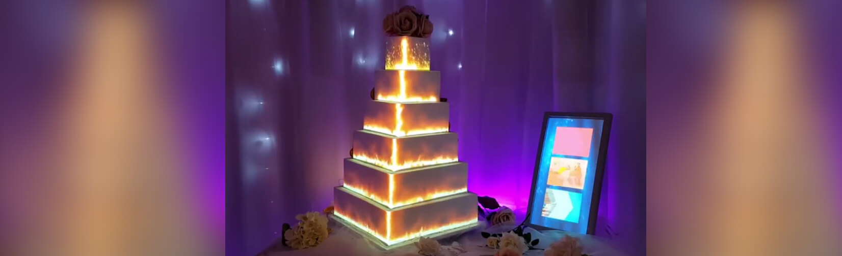 couples project moving video images onto their wedding cakes